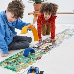 Kids playing with ZIGZAG Book Vehicles