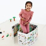 Girl playing with ZIGZAG Book Vehicles